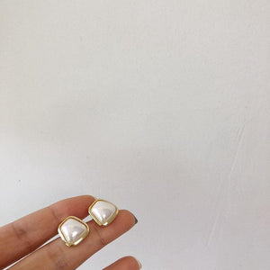 Round bulging square pearl silver needle stud earrings