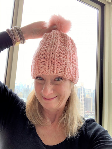 melissa with a bulky pink hat on her head