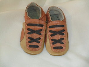 Age: 18-24 Months. Buff and Sandy Brown with Dark Brown Criss-Cross Laces.  Sole:  Gold.