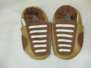 Age: 18-24 Months. Top: Gold and Caramel with Creamy White Straight Laces. Sole: Gold.