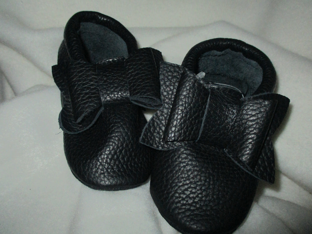 Age/Size: 18-24 Months. Top: Black with Black Bow. Sole: Black.