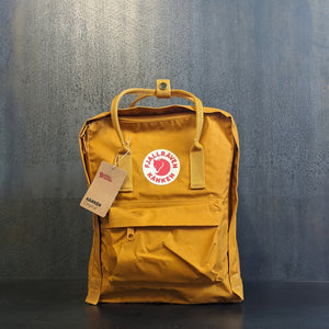 Acorn Yellow Kanken backpack