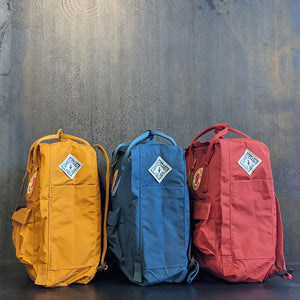Three colors of Kanken Backpacks sewn with the Piper & Leaf diamond logo