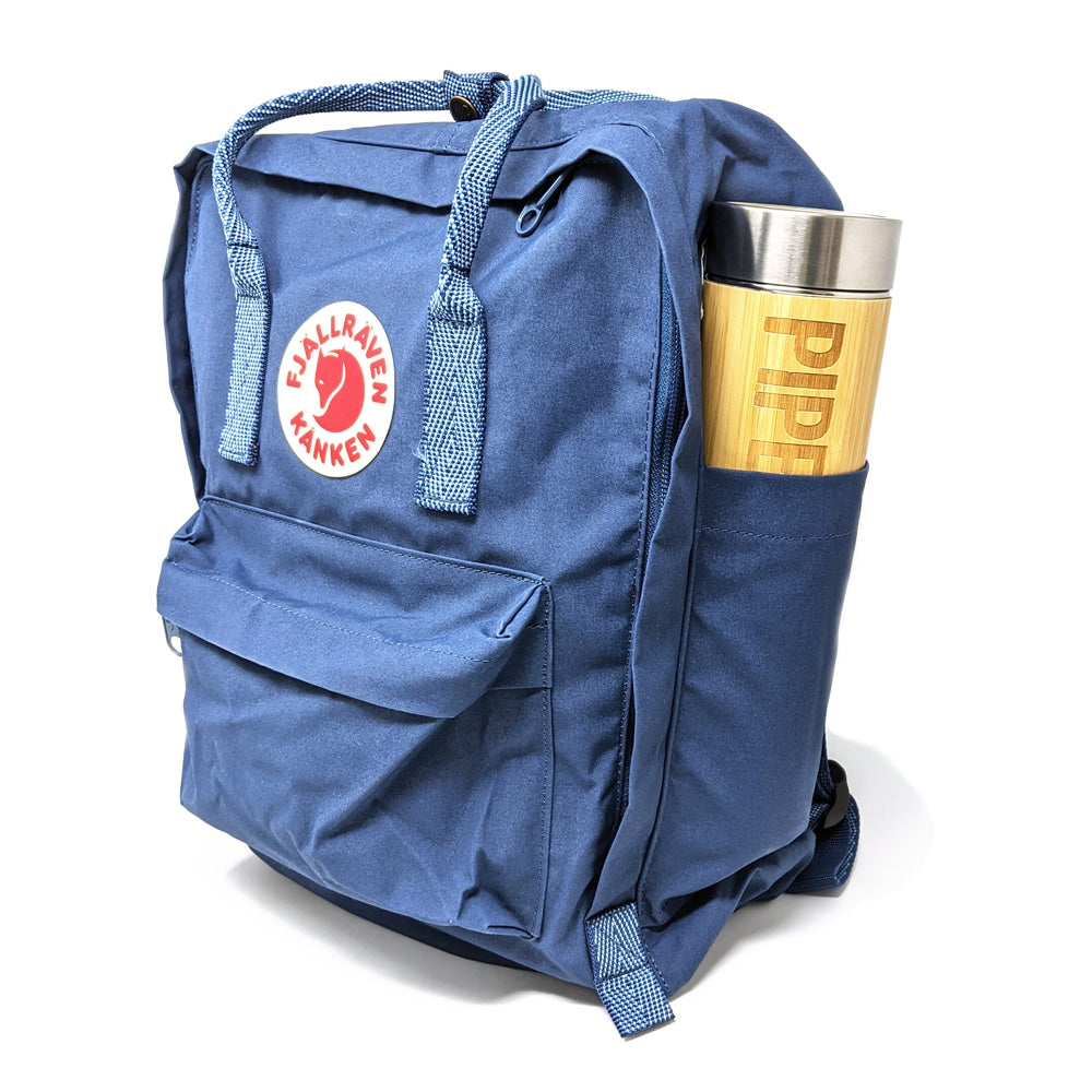 A Fjällräven Kånken backpack, co-branded with Piper & Leaf, showing the perfect fit of the bamboo Tisane Tumbler strainer