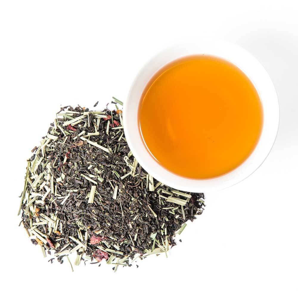 a pile of loose leaf next to a cup of brewed tea - Lemon Berry Blush
