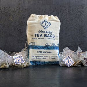 Tea bags piled around a 9ct muslin bag (Piper Mint Blues)