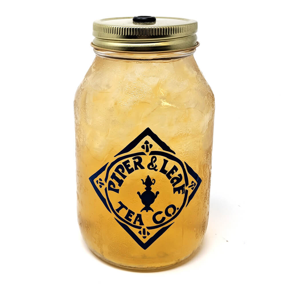 A quart mason jar filled with an iced Sweetie Pie Chai tea