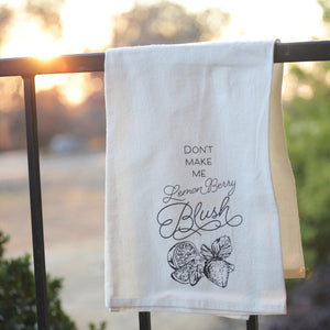 "Tea Towel: ""Don't Make Me Lemon Berry Blush"" with sketch of a sliced lemon and strawberries"