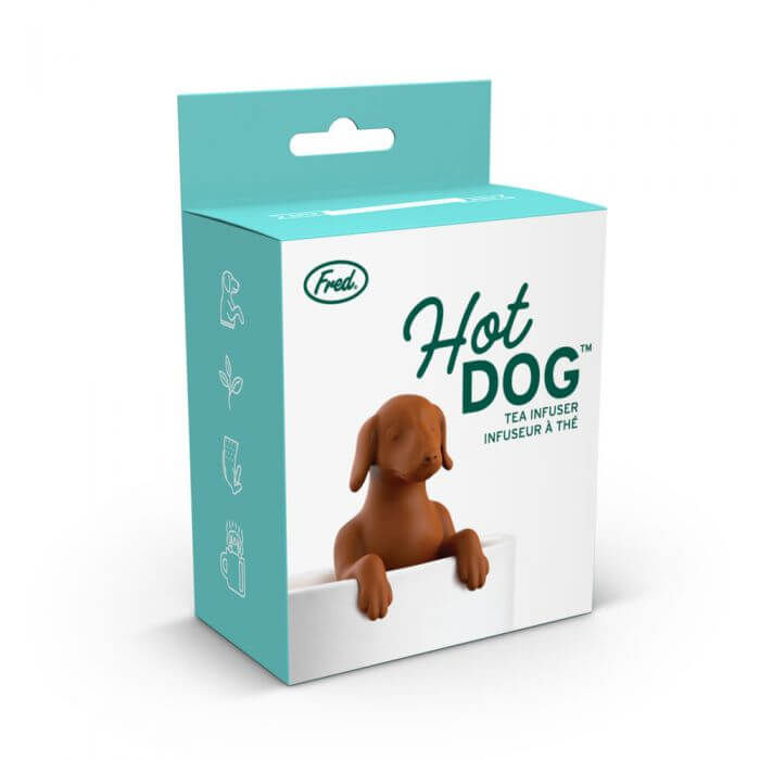 The box for the dog shaped Fred-brand tea strainer in a glass mug: the Hot Dog