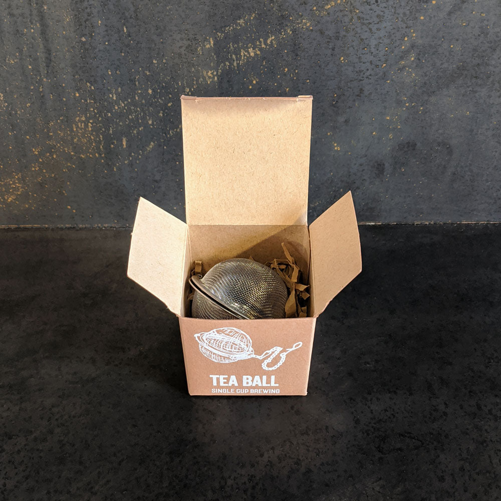 Mesh tea ball strainer in the box