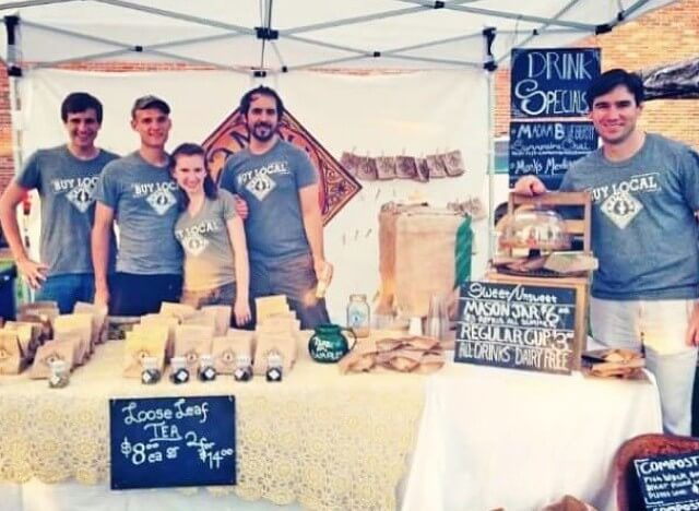 A photo of the early Piper & Leaf booth in 2013 run by three of the owners, a sibling, and a friend