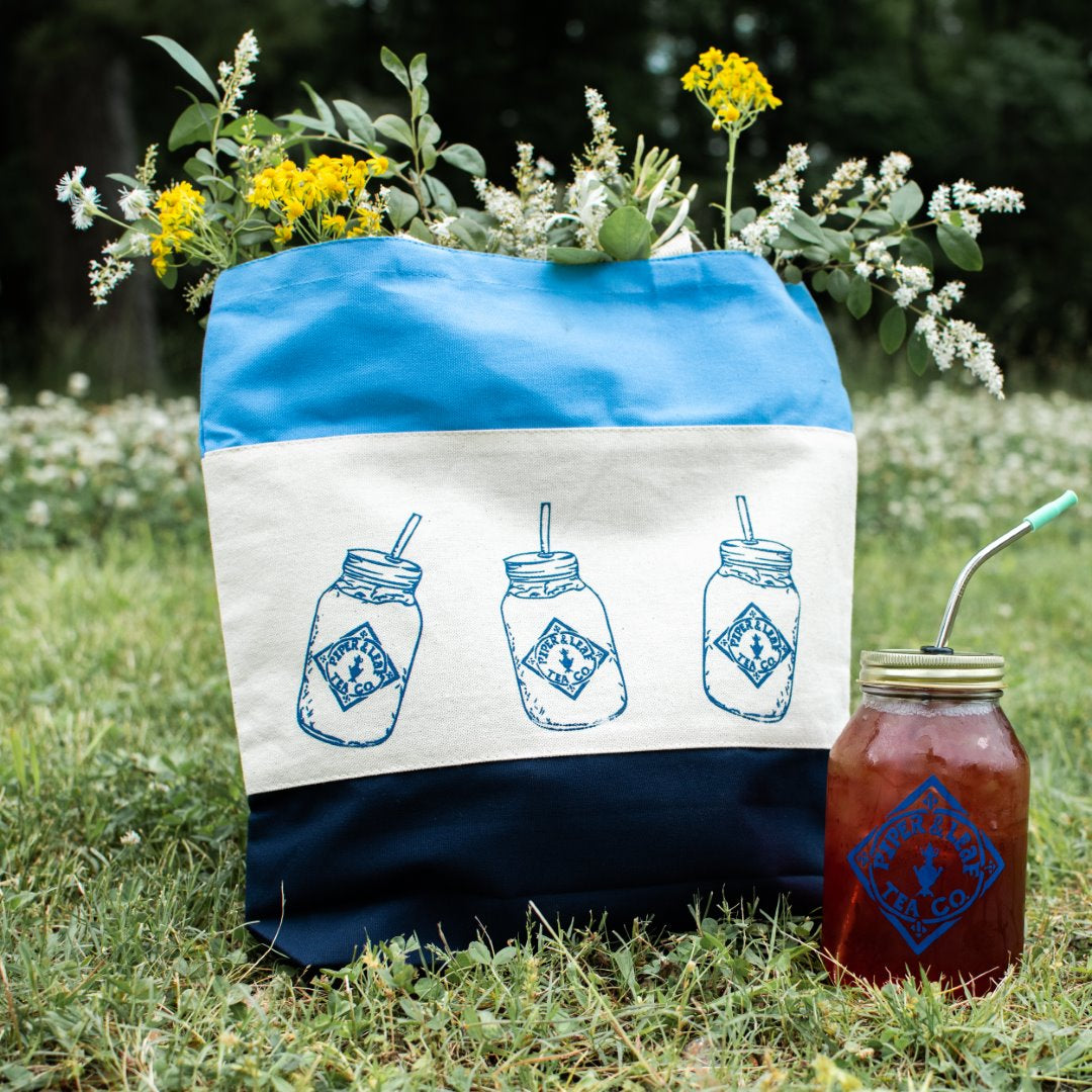 A jar of iced tea and a tote bag printed with images of mason jars