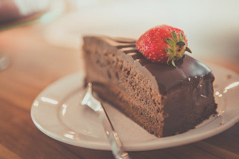 a slice of chocolate cake with strawberries
