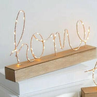 Wood sign with lights and home letter word