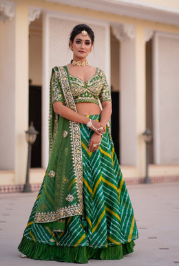 Dark Green color Leheriya Lehenga with Gota Patti, Zardozi, Thread & Applique work.