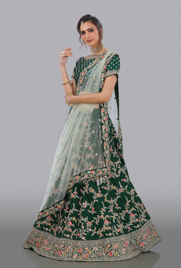 Faux Dupion Lehenga in Dark Green color with Zari Embroidery, Resham Embroidery, Sequins Embellishment work.