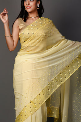 Chiffon Saree in Yellow color with Cutdana, Pearl, Thread work.