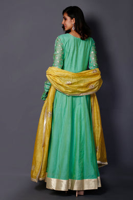Suit in Light Green color with Pittan work.