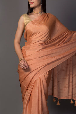 Chinon Saree in Orange color.