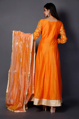 Suit in Orange color with Pittan work.