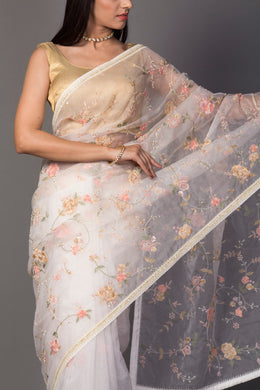 Organza Saree in Cream color with Cutdana, Pearl, Thread work.