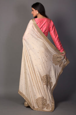 Handloom silk Saree in Cream color with Cutdana, Sequins, Zardozi work.