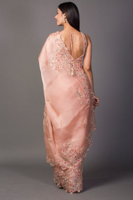 Organza Saree in Peach color with Cutdana, Pearl, Sequins work.