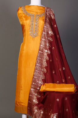 Silk Unstitched Suit in Gold color with Mirror, Zardozi work.