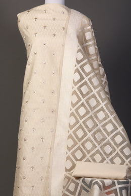 Chanderi dobby Unstitched Suit in Cream color with Thread work.