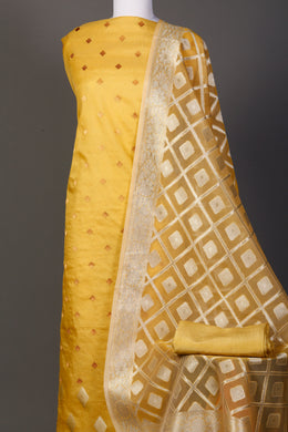 Chanderi Unstitched Suit in Gold color with Thread work.