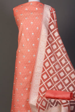 Chanderi dobby  Unstitched Suit in Peach color with Thread work.
