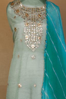 Leheriya Unstitched Suit in Light Green color with Gota Patti work.