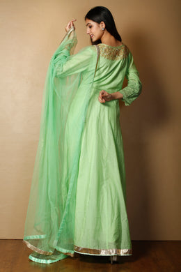 Suit in Light Green color with Dori, Gota Patti, Zardozi work.