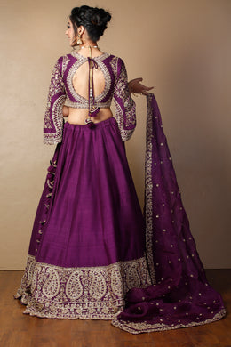 Raw silk Lehenga in Purple color with Pearl, Stone, Zardozi work.