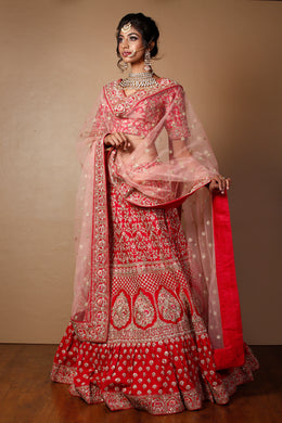 Raw silk Lehenga in Red color with Aari, Pearl, Sequins work.