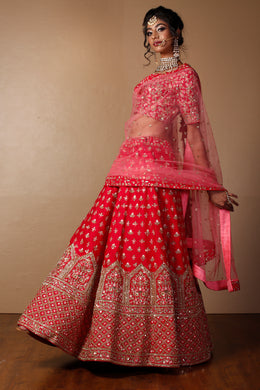 Raw silk Lehenga in Red color with Aari, Pearl, Sequins, Thread work.