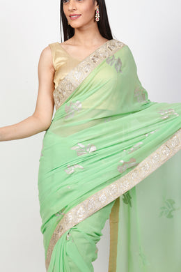 Georgette Saree with Pittan work.