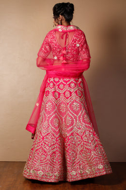 Raw silk Lehenga in Pink color with Cutdana, Sequins, Thread, Zari work.