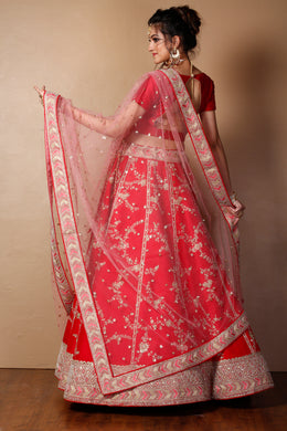 Raw silk Lehenga in Red color with Aari, Pearl, Sequins, Zari work.