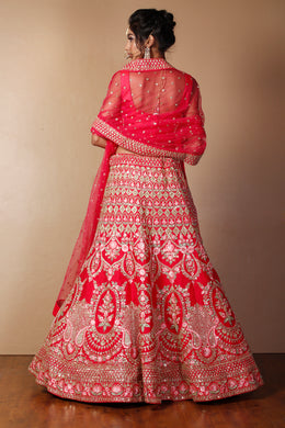 Raw silk Lehenga in Red color with Aari, Pearl, Sequins, Thread, Zardozi, Zari work.