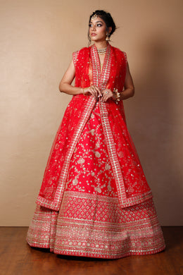 Raw silk Lehenga in Red color with Aari, Sequins, Thread, Zardozi, Zari work.