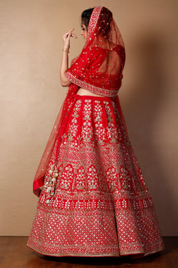Raw silk Lehenga in Red color with Cutdana, Pearl, Sequins, Thread work.