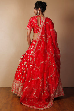 Raw silk Lehenga in Red color with Aari, Gota Patti, Sequins work.