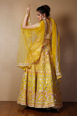 Raw silk Lehenga in Yellow color with Mirror, Thread, Zari work.