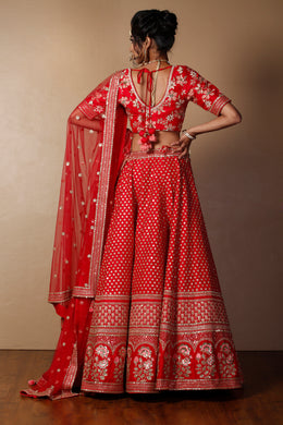 Raw silk Lehenga in Red color with Aari, Sequins, Thread work.