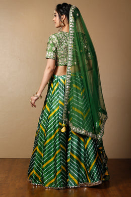 Tussar silk Lehenga in Dark Green color with Gota Patti, Thread, Zardozi work.