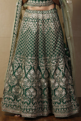 Raw silk Lehenga in Dark Green color with Gota Patti, Pearl, Sequins work.