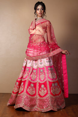 Raw silk Lehenga in Red color with Aari, Pearl, Sequins, Thread, Zardozi work.