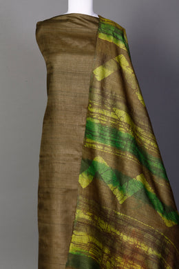 Tussar Unstitched Suit in Dark Green color with Tie & Dye work.