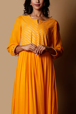 Georgette Kurti in Yellow color with Dori, Gota, Sequins work.